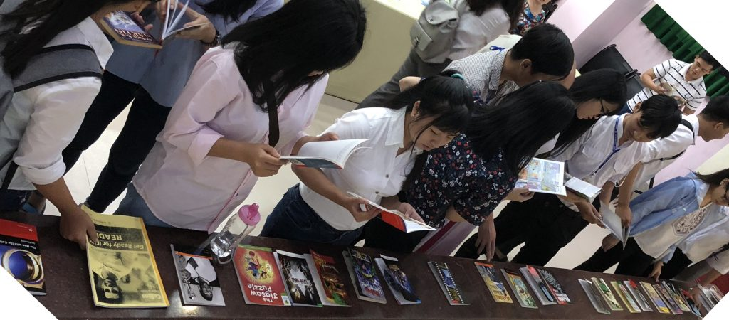 Students Examining Graded Readers at Dong Thap U.